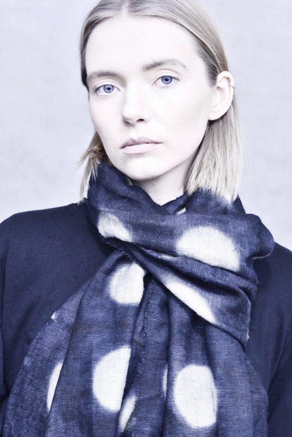 women model with dark blue scarf